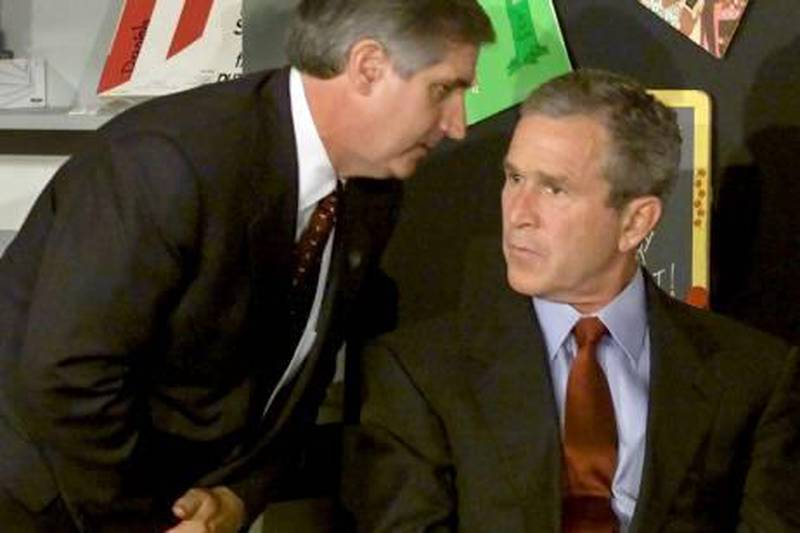 """ATTENTION EDITORS - THIS FILE PICTURE IS ONE OF 83 TO ACCOMPANY THE TENTH ANNIVERSARY OF THE SEPTEMBER 11 ATTACKS. SEARCH FOR KEYWORD """"9/11"""" TO SEE ALL THE IMAGES (PXP901-PXP983)  U.S. President George W. Bush listens as White House Chief of Staff Andrew Card informs him of a second plane hitting the World Trade Center while Bush conducting a reading seminar at the Emma E. Booker Elementary School in Sarasota, Florida in this September 11, 2001 file photo. September 11th marks the 10th anniversary of the 9/11 attacks where nearly 3,000 people died when four hijacked airliners were used in coordinated strikes on the Pentagon and the World Trade Center towers. The fourth plane crashed in Pennsylvania. REUTERS/Win McNamee/Files  (UNITED STATES - Tags: CRIME DISASTER POLITICS ANNIVERSARY)   9-11 nine eleven Sept 11th terror attack *** Local Caption ***  PXP968_USA-SEPT11-_0901_11.JPG"""