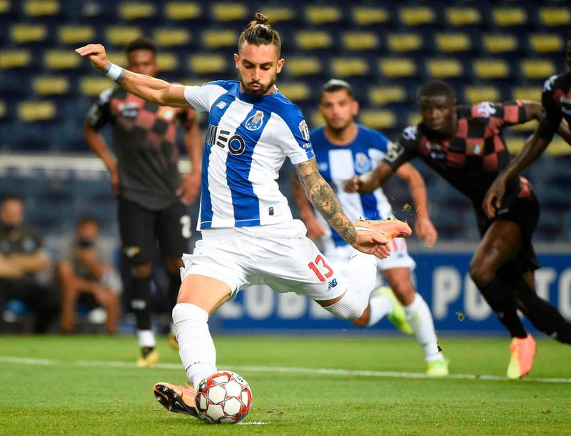 (FILES) In this file photo taken on July 20, 2020, FC Porto's Brazilian defender Alex Telles takes a penalty-shot to score his team´s third goal  during the Portuguese League football match FC Porto against Moreirense FC at the Dragao stadium in Porto. Manchester United responded to their defensive woes by signing Brazil left-back Alex Telles from Porto for a reported initial fee of 13.5 million ($14.8 million) on Monday, October 5. / AFP / MIGUEL RIOPA