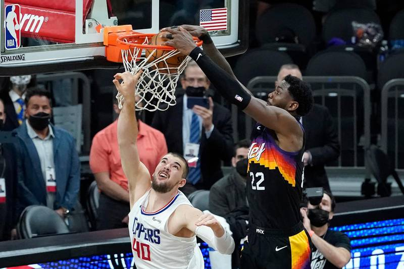 Phoenix Suns center Deandre Ayton, right, scores over Los Angeles Clippers center Ivica Zubac during the second half of Game 2 of the NBA basketball Western Conference Finals, Tuesday, June 22, 2021, in Phoenix. (AP Photo/Matt York)