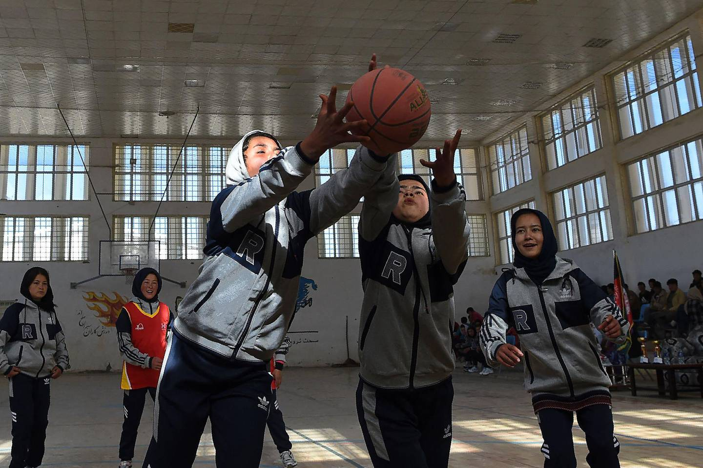 Hazara female basketball players take part in an event on International Women's Day in Bamiyan Province on March 8, 2021. / AFP / WAKIL KOHSAR