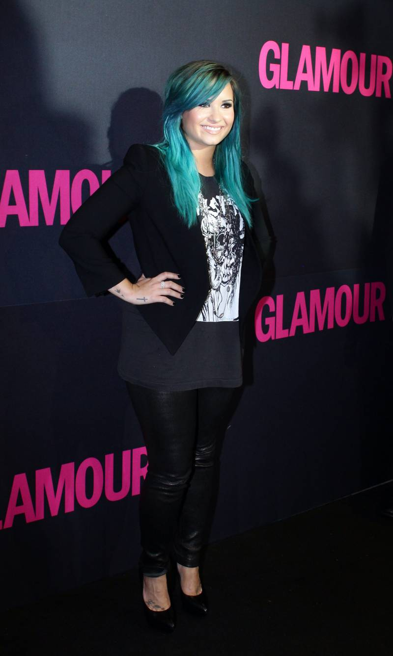 epa03905229 US singer Demi Lovato poses upon arrival at the 15th anniversary of magazine Glamour in Mexico City, Mexico, 10 October 2013.  EPA/JOSE MENDEZ