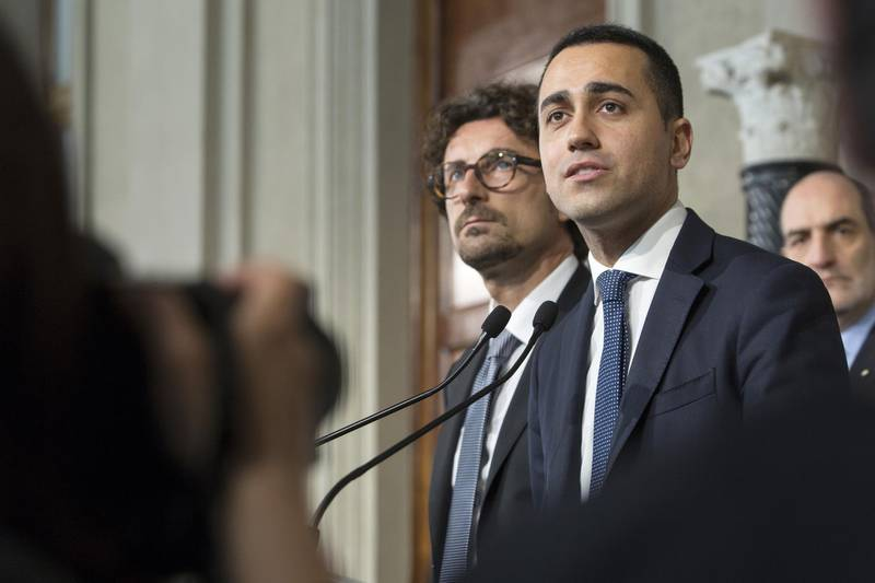 Luigi Di Maio, leader of the Five Star Movement, right, speaks at a news conference following his meeting with Italy's President Sergio Mattarella at the Quirinale Palace in Rome, Italy, on Monday, May 7, 2018. Mattarella is holding a new round of talks with parties in a final attempt to form a political government two months after inconclusive elections. Photographer: Giulio Napolitano/Bloomberg