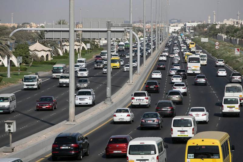 ABU DHABI, UNITED ARAB EMIRATES, May 13, 2015:   Cars flow in thickening traffic on Sheikh Zayed road in Abu Dhabi during the beginning of rush hour on Wednesday, May 13, 2015. A recent yougov survey-it says commute times in Abu Dhabi are down, and drivers are happier, but the roads still have a lot of inattentive drivers. (Silvia Razgova / The National)  (Usage: May 13, 2015, Section: NA, Reporter: ) *** Local Caption ***  SR-150513-traffic17.jpg