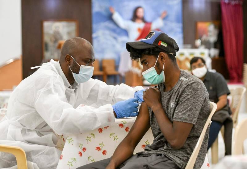 A man receives a dose of a vaccine against the coronavirus disease (COVID-19)at St. Paul's Church in Abu Dhabi, United Arab Emirates January 16, 2021. REUTERS/Khushnum Bhandari
