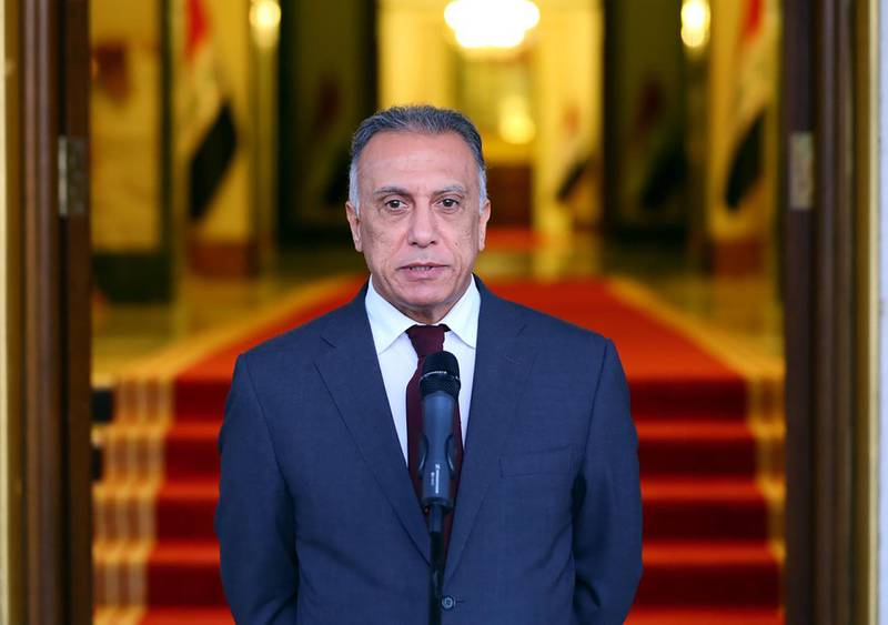 """A handout image released by the press office of Iraqi Prime Minister Mustafa Kadhemi on May 9, 2020, shows him delivering a speech following the ministerial meeting of the new Iraqi cabinet in Baghdad.  - RESTRICTED TO EDITORIAL USE - MANDATORY CREDIT """"AFP PHOTO / IRAQI PRIME MINISTER'S OFFICE"""" - NO MARKETING - NO ADVERTISING CAMPAIGNS - DISTRIBUTED AS A SERVICE TO CLIENTS   / AFP / IRAQI PRIME MINISTER'S PRESS OFFICE / - / RESTRICTED TO EDITORIAL USE - MANDATORY CREDIT """"AFP PHOTO / IRAQI PRIME MINISTER'S OFFICE"""" - NO MARKETING - NO ADVERTISING CAMPAIGNS - DISTRIBUTED AS A SERVICE TO CLIENTS"""