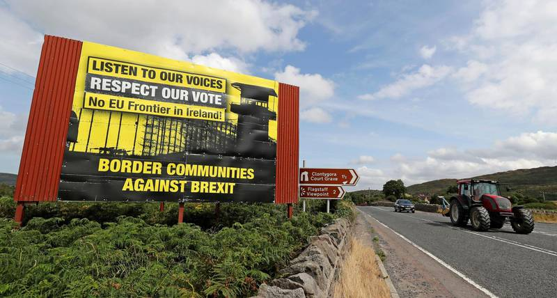 Anti Brexit billboards are seen on the northern side of the border between Newry, in Northern Ireland, and Dundalk, in the Republic of Ireland, on Wednesday, July 18, 2018. British Prime Minister Theresa May is scheduled to make her first visit to the Irish border since the Brexit referendum later this week.  (Niall Carson/PA via AP)