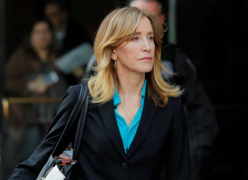 FILE PHOTO: Actor Felicity Huffman, facing charges in a nationwide college admissions cheating scheme, leaves federal court in Boston, Massachusetts, U.S., April 3, 2019.  REUTERS/Brian Snyder/File Photo
