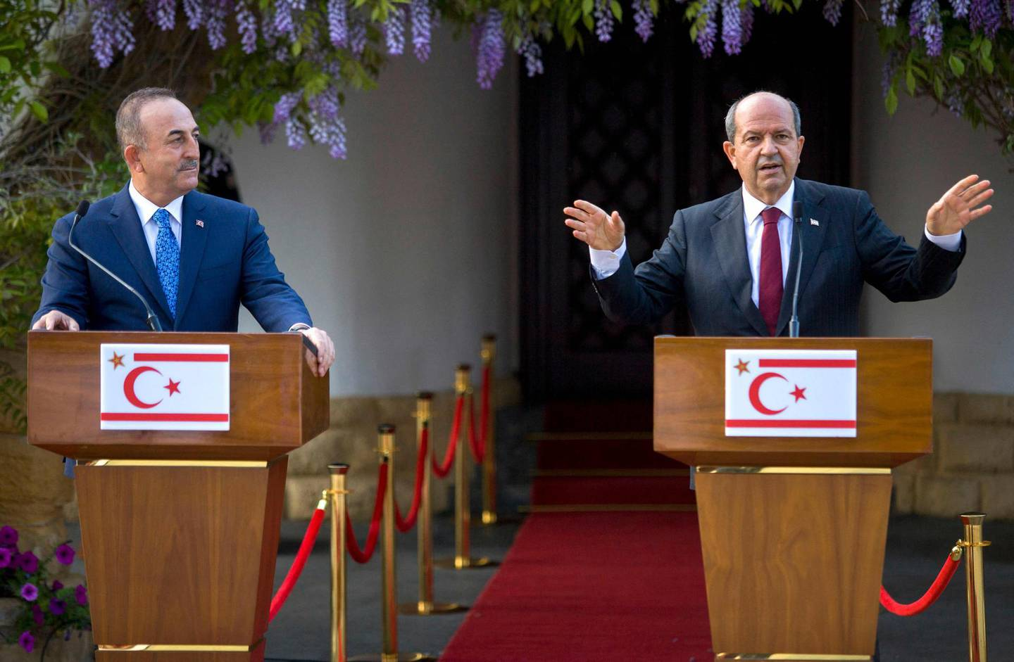 Turkish-Cypriot leader Ersin Tatar (R) speaks during a joint press conference with Turkey's Foreign Minister Mevlut Cavusoglu in the northern part of Cyprus' divided capital Nicosia, under control of the self-proclaimed Turkish Republic of North Cyprus (TRNC), on April 16, 2021. / AFP / Birol BEBEK
