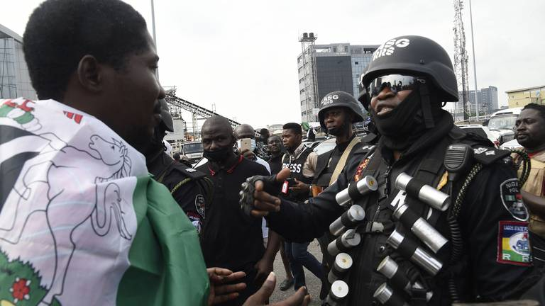 An image that illustrates this article Tear gas as Nigerians mark year since deadly Lekki toll gate shooting