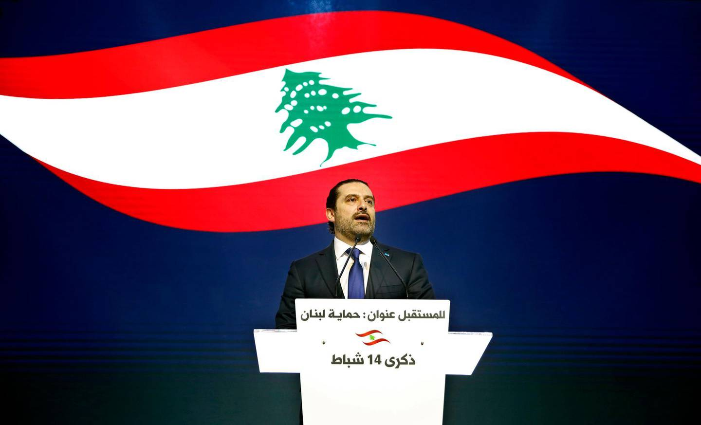 FILE - In this Wednesday, Feb. 14, 2018 file photo, Lebanese Prime Minister Saad Hariri, speaks during a ceremony to mark the 13th anniversary of the assassination of his father, former Prime Minister Rafik Hariri, in Beirut, Lebanon. The office of Lebanon's Prime Minister says he has received an invitation to visit Saudi Arabia from an envoy of the Gulf monarch. It's the first such gesture following tension between the two countries in the wake of the now-reversed resignation of Saad Hariri. (AP Photo/Bilal Hussein, File)