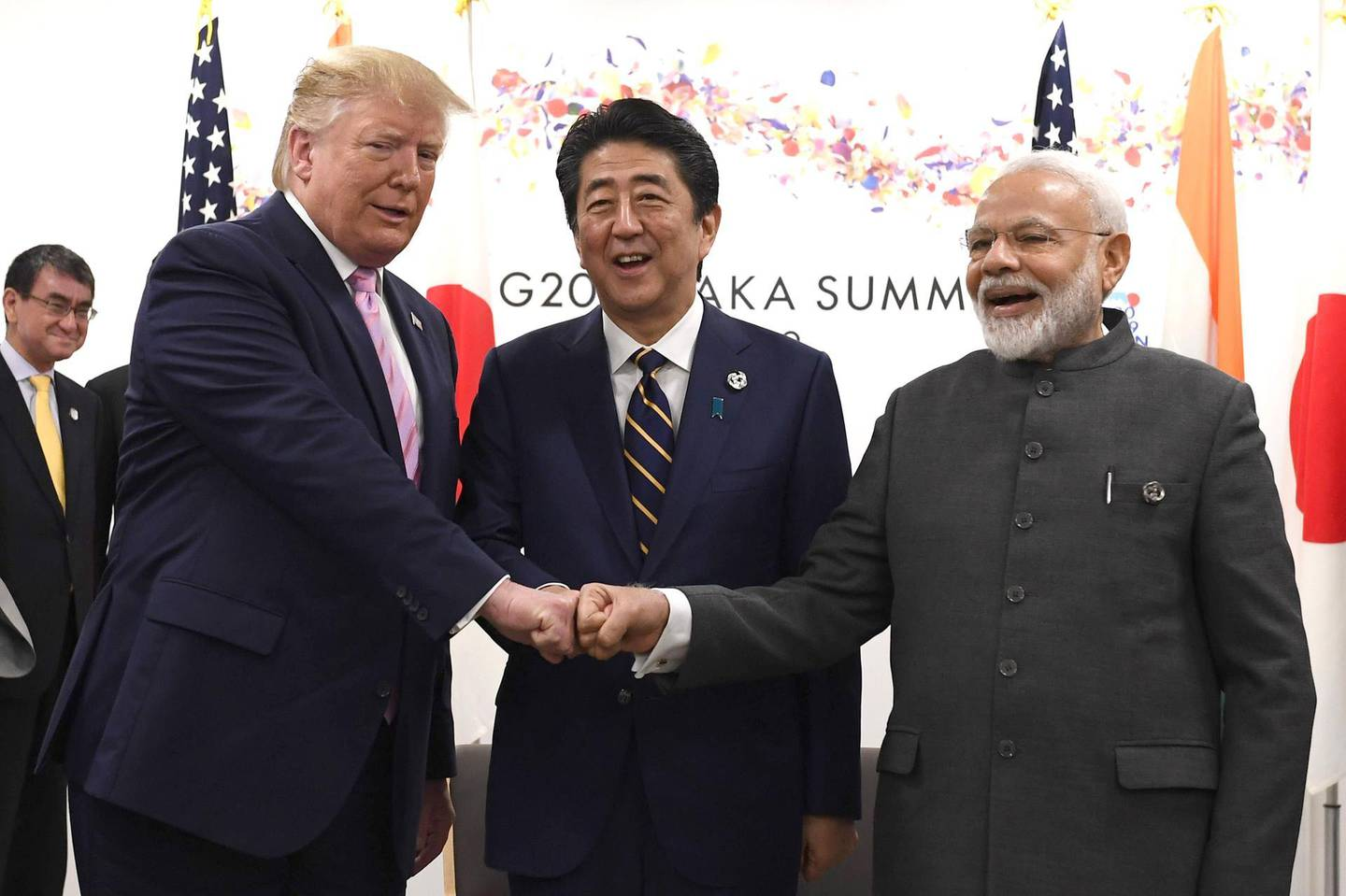 U.S. President Donald Trump, left, Shinzo Abe, Japan's prime minister, center, and Narendra Modi, India's prime minister, place their fists together during a trilateral meeting at the Group of 20 (G-20) summit in Osaka, Japan, on Friday, June 28, 2019. The world's most powerful leaders are gathering in Japan for meetings that may set the direction for the global economy and make the difference between war and peace in geopolitical hotspots. Photographer: Carl Court/Pool via Bloomberg