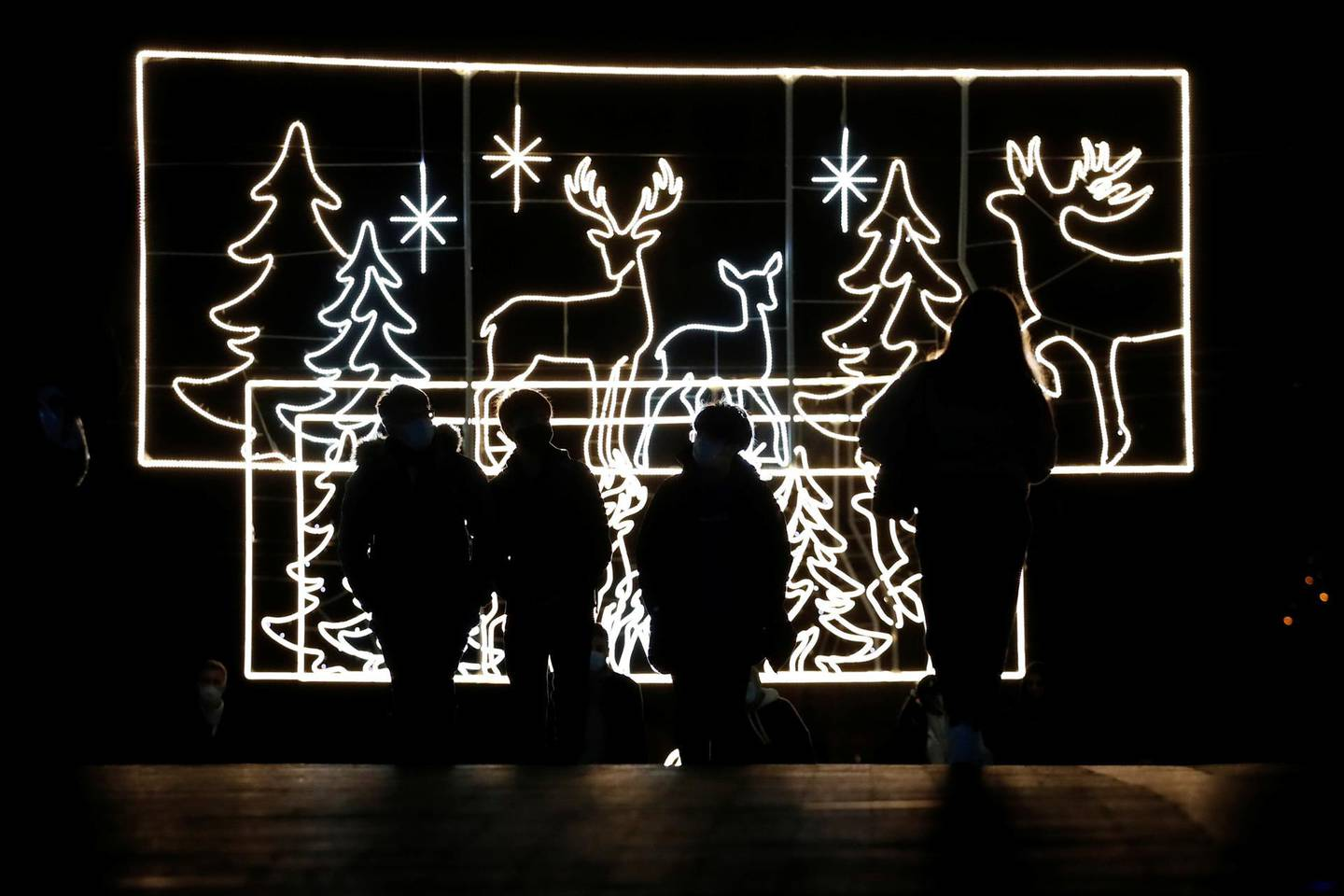 Shoppers are seen walking past christmas lights in Bullring shopping centre, after new nationwide restrictions were announced during the coronavirus disease (COVID-19) outbreak in Birmingham, Britain, November 4, 2020. REUTERS/Andrew Boyers