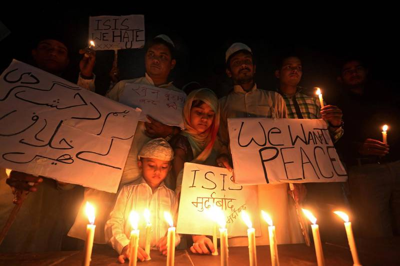 epa08802190 (FILE) - Indian Muslims and children hold candles and slogans against ISIS as they organize a candle light vigil for the victims of the deadly 13 November terrorist attacks in Paris, in Bhopal, India, 15 November 2015 (reissued 06 November 2020). The French capital Paris on 13 November 2020 sees the 5th anniversary of a series of coordinated terrorist attacks in downtown Paris and its northern suburb of Saint-Denis that cost the lives of 131 people and left more than 400 people, partially seriously, injured and traumatized.  EPA/SANJEEV GUPTA *** Local Caption *** 52383253