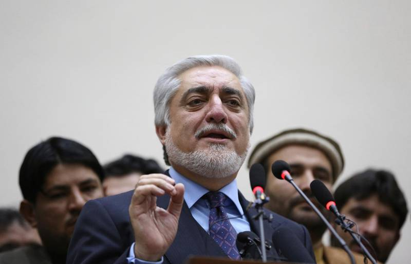 Afghan presidential candidate Abdullah Abdullah, center, addresses the media following a conference with his party members in Kabul, Afghanistan, Sunday, Jan. 26, 2020. (AP Photo/Rahmat Gul)