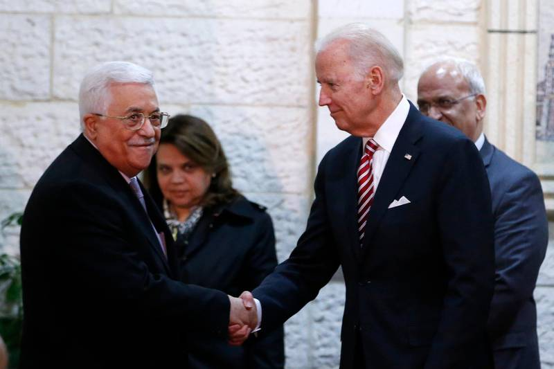 US Vice President Joseph Biden (R) shakes hands with Palestinian president Mahmud Abbas as they arrive for a meeting in the West Bank city of Ramallah on March 9, 2016. - Six separate attacks took place shortly before or after Biden's arrival the day before, including a stabbing spree on Tel Aviv's waterfront by a Palestinian who killed an American tourist and wounded 12 other people. (Photo by ABBAS MOMANI / AFP)