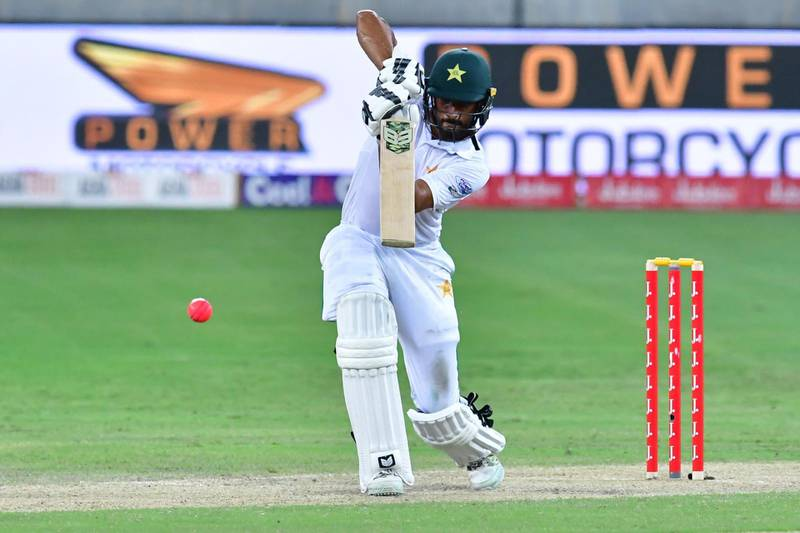 This photograph taken Ocotber 7, 2017 shows Shan Masood of Pakistan playing a shot during the second day of the second Test cricket match between Sri Lanka and Pakistan at Dubai International Stadium in Dubai. / AFP PHOTO / GIUSEPPE CACACE