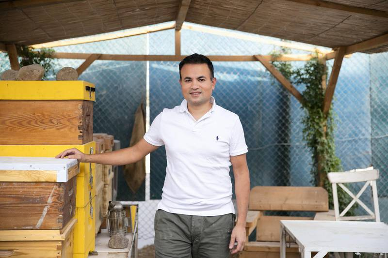 DUBAI, UNITED ARAB EMIRATES - JUNE 7, 2018.   Jameel Khan at the beehive farm in Dubai Sustainable City. A new programme 'My Hive,' was launched by The Sustainable City (TSC) in partnership with the Apiculture and Nature for the Betterment of Health and Beauty (ANHB). The programme grants individuals and corporations the opportunity to adopt a beehive of their own.  The programme was launched by Shaikh Salem Sultan Al Qasimi, Chairman of ANHB, after the TSC purchased 250 new beehives to provide residents with organic honey and raise awareness of the important ecological role of bees.  (Photo by Reem Mohammed/The National)  Reporter: Ramola Talwar Section: NA