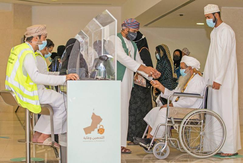 People register to get vaccinated at the Oman Convention & Exhibition Centre in the capital Muscat on June 23, 2021 during the second phase of the national immunisation plan against COVID-19. / AFP / Haitham AL-SHUKAIRI