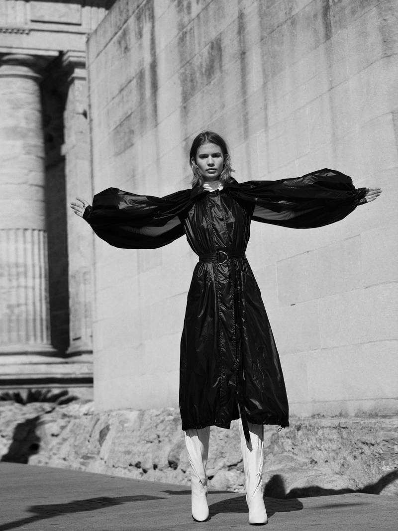 OUT OF SHADOWS.Photography   Ezra Patchett   fashion director   Sarah MaiseyCoat, Dh8,150; and boots, Dh9,809, both from Givenchy