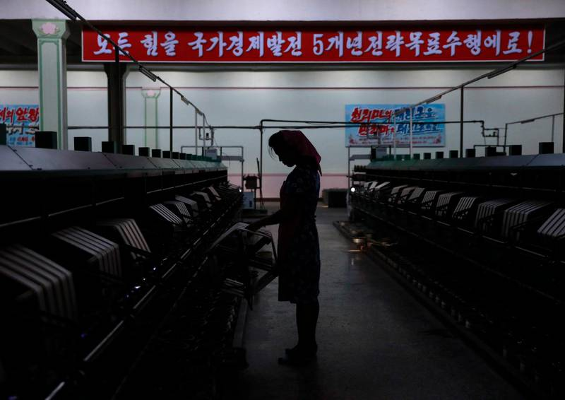 epa07134709 (FILE) - A North Korean woman works at a silk factory in Pyongyang, North Korea, 07 September 2018 (reissued 01 November 2018). According to a report by Human Rights Watch on 01 November, women in North Korea are subjected to widespread sexual abuse by officials. The report is based on interviews conducted with refugees from the reclusive country, detailing accounts of reape and sexual abuse that have become 'normal' and an accepted part of life to oridnary women.  EPA/HOW HWEE YOUNG