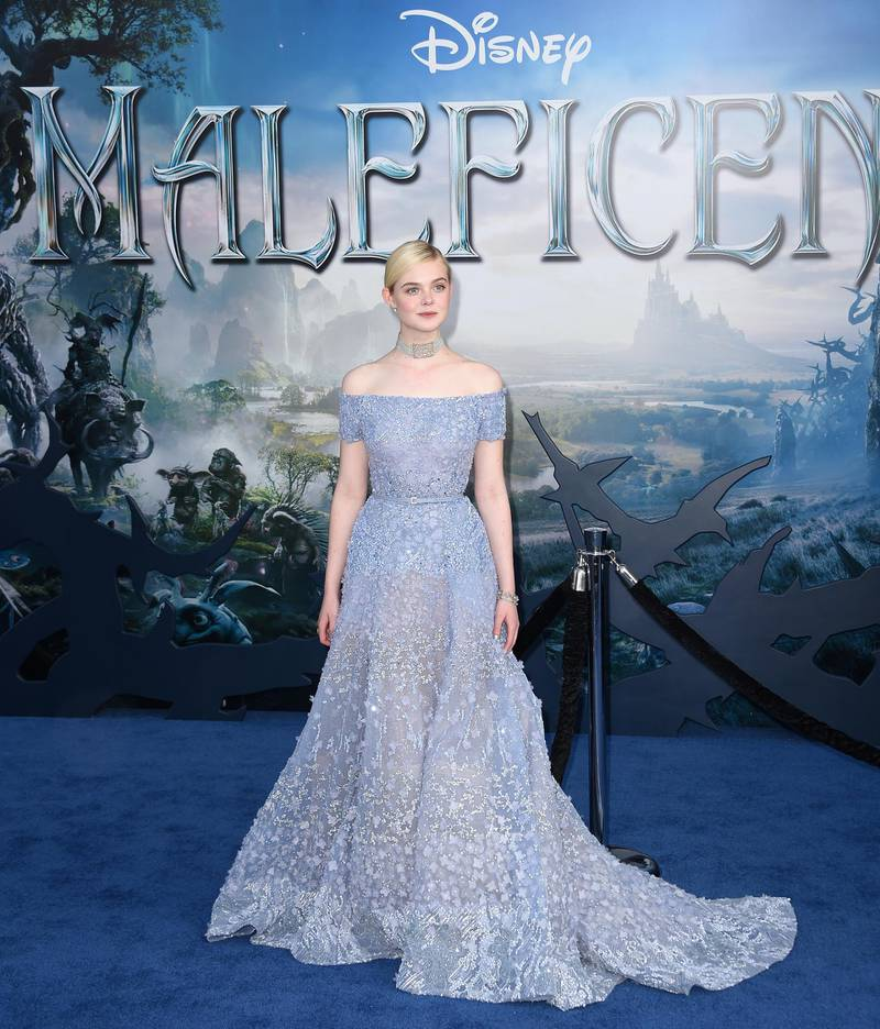"""Actress Elle Fanning arrives for the world premiere of Disney's """"Maleficent,"""" May 28, 2014, at El Capitan Theatre in Hollywood, California. AFP PHOTO / ROBYN BECK (Photo by ROBYN BECK / AFP)"""