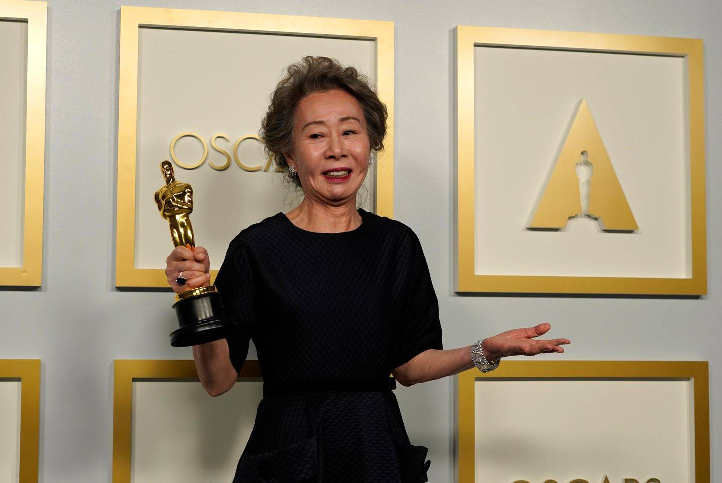 epa09160842 Youn Yuh-jung, winner of the award for best actress in a supporting role for 'Minari,' poses in the press room at the 93rd annual Academy Awards ceremony at Union Station in Los Angeles, California, USA, 25 April 2021. The Oscars are presented for outstanding individual or collective efforts in filmmaking in 24 categories. The Oscars happen two months later than originally planned, due to the impact of the coronavirus COVID-19 pandemic on cinema.  EPA/Chris Pizzello / POOL *** Local Caption *** 55864152