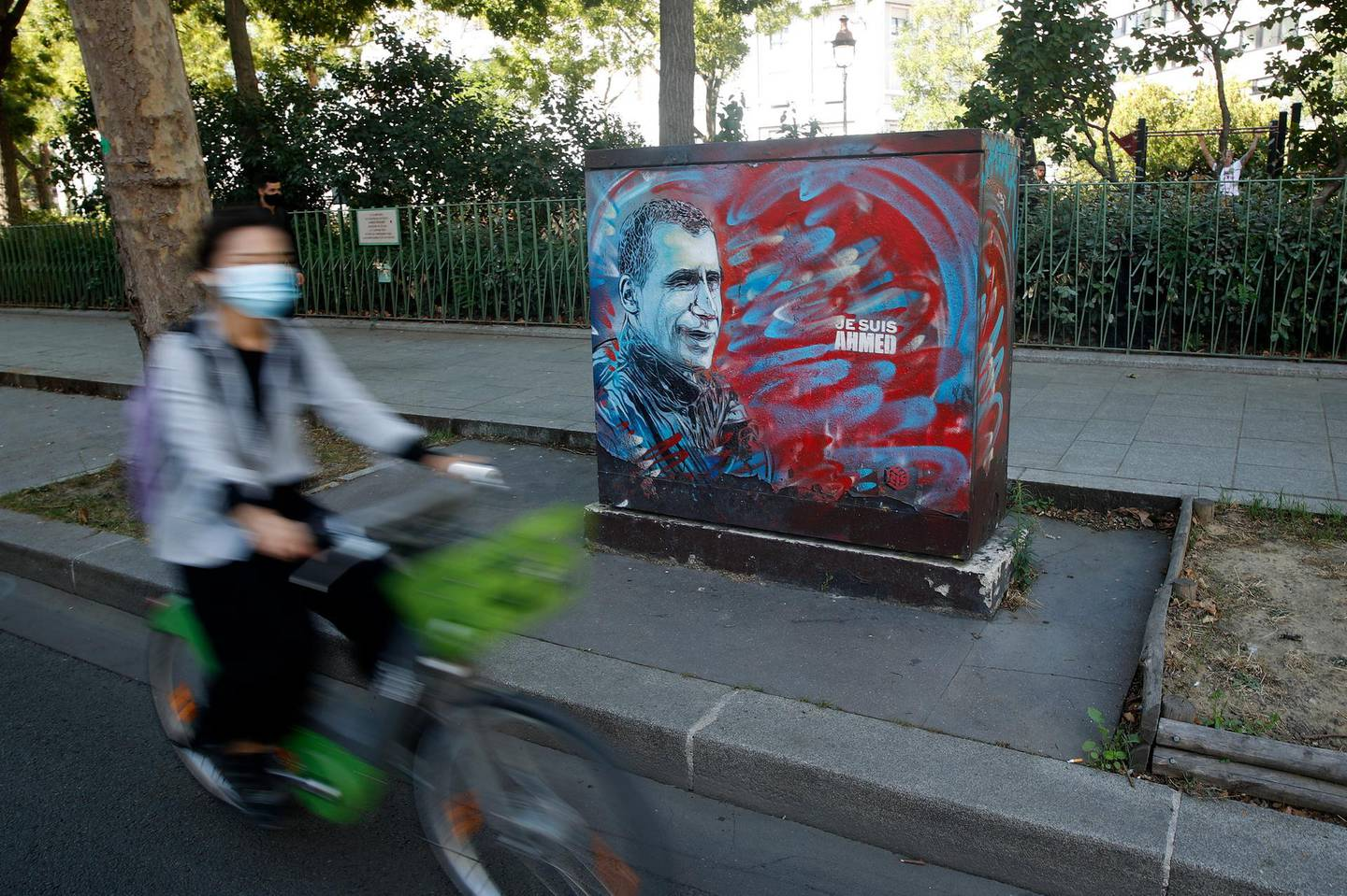 epa08641145 A cyclist passes by a mural depicting police officer Ahmed Merabet who was shot dead by gunmen following the 07 January 2015 attack on Charlie Hebdo, on the opening day of the attacks trial, in Paris, France, 02 September 2020. The Charlie Hebdo terrorist attacks in Paris happened on 07 January 2015, with the storming of armed Islamist extremists of the satirical newspaper, starting three days of terror in the French capital.  EPA/YOAN VALAT