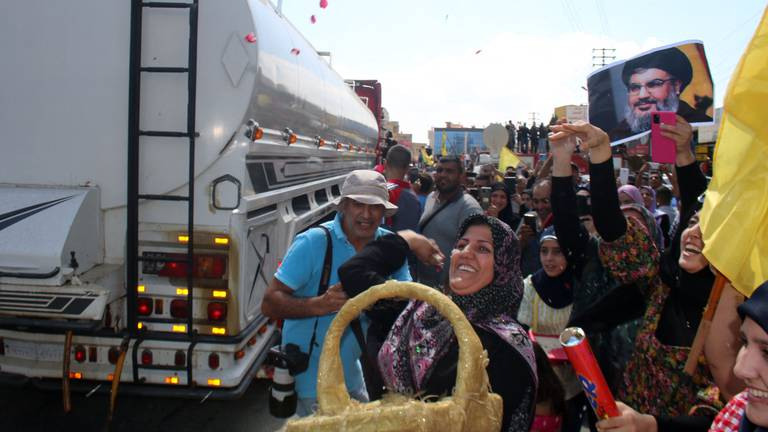 An image that illustrates this article Hezbollah supporters celebrate as Iranian fuel arrives in Lebanon