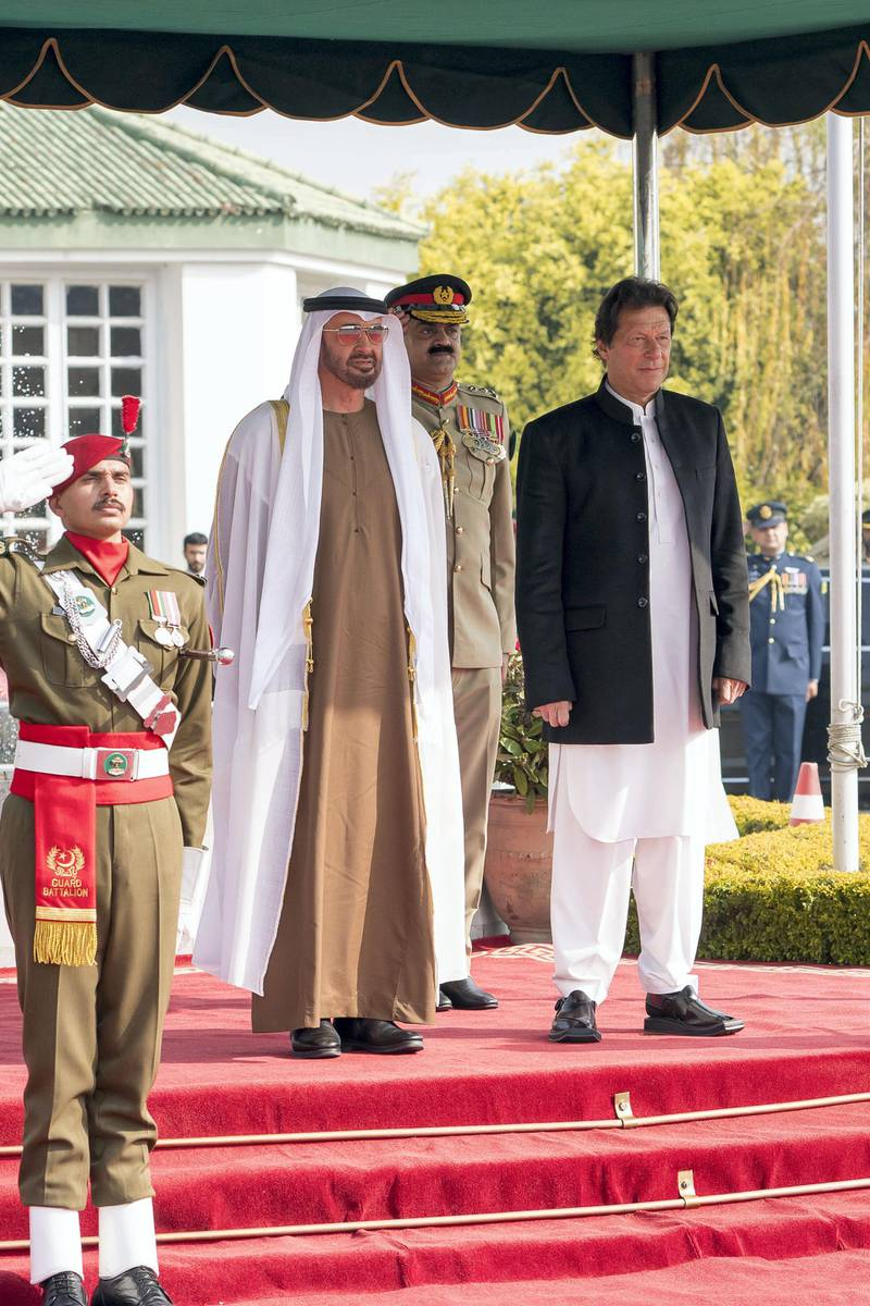 ISLAMABAD, PAKISTAN - January 06, 2019: HH Sheikh Mohamed bin Zayed Al Nahyan, Crown Prince of Abu Dhabi and Deputy Supreme Commander of the UAE Armed Forces (2nd R) and HE Imran Khan, Prime Minister of Pakistan (R), stand for a national anthem, during a reception held at the Prime Minister's residence. ( Rashed Al Mansoori / Ministry of Presidential Affairs ) ---