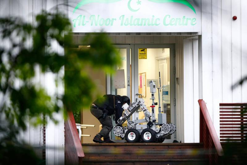 Police attend the scene after a shooting inside the al-Noor Islamic center mosque in Baerum outside Oslo.  Norwegian police say one person has been shot and lightly injured during the shooting incident at a mosque in a western suburb of the capital.(Terje Pedersen / NTB scanpix via AP)
