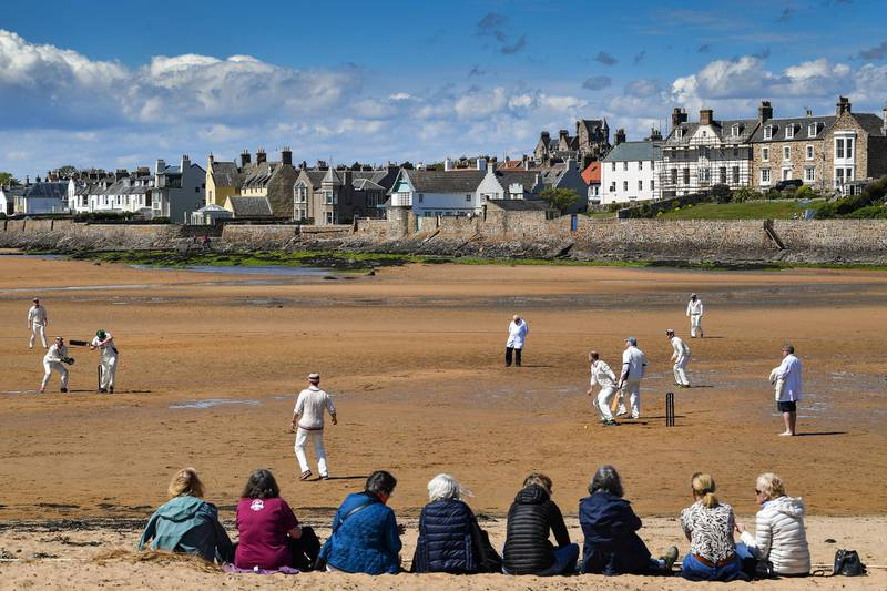 ELIE, ENGLAND - MAY 12: Cricket players from the Ship Inn and Borderers teams hold the first match of the season at the beach on May 12, 2019 in Elie, Scotland. The Ship Inn pub is the only cricket team in the United Kingdom to play their matches on a beach. Over the course of a season they hold regular fixtures against Scottish clubs as well as touring teams from across the world. (Photo by Jeff J Mitchell/Getty Images) *** BESTPIX ***