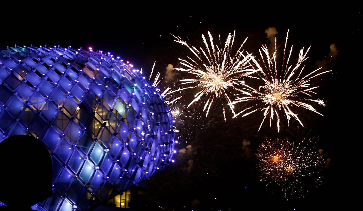 epa06812368 Fireworks illuminates the sky over the Yas Viceroy luxury hotel on the first day of the Muslim holiday of Eid Al-Fitr at the Marina on Yas Island, Abu Dhabi, United Arab Emirates, late 15 June 2018 (issued 16 June 2018). Muslims around the world are celebrating Eid al-Fitr, the three day festival marking the end of the Muslim holy month of Ramadan, it will be observed on 15th or 16th of June depending on the lunar calendar. Eid al-Fitr is one of the two major holidays in Islam.  EPA/ALI HAIDER