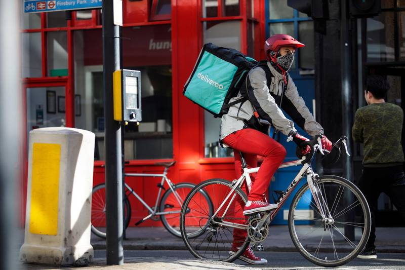 LONDON, ENGLAND - FEBRUARY 16: A Deliveroo rider cycles through central London on February 16, 2018 in London, England. Millions of part-time and flexible workers in the so-called gig economy are to receive new rights including sick and holiday pay under a new government reform. (Photo by Jack Taylor/Getty Images)