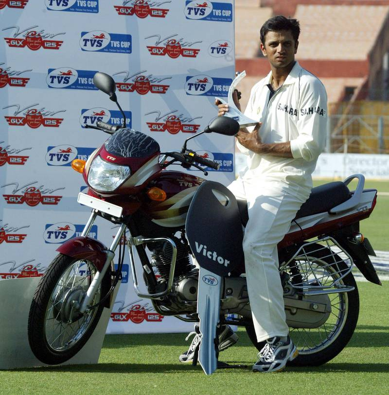 Indian vice captain Rahul Dravid poses with the man of the match trophy as he sits on a motorbike after winning the second test cricket match between India and Pakistan in Calcutta March 20, 2005. India won the match by 195 runs. REUTERS/Sucheta Das  SD/