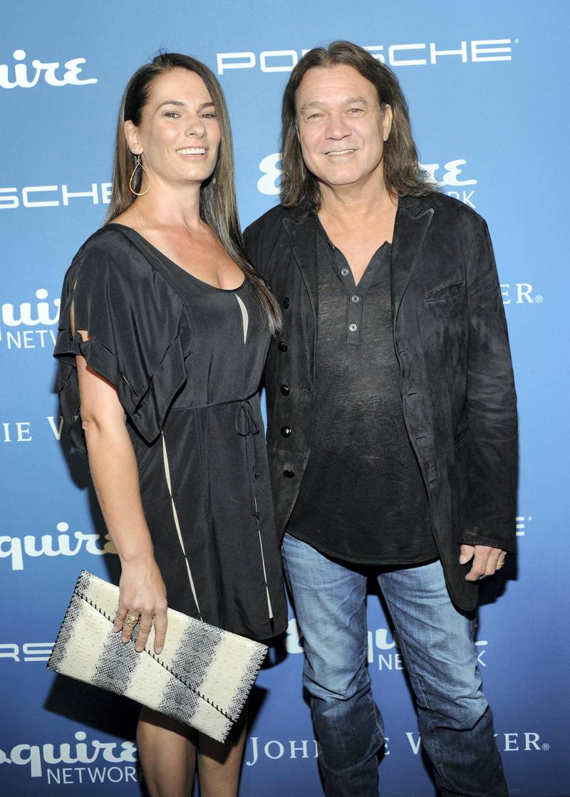 NEW YORK, NY - SEPTEMBER 17: Janie Liszewski and Musician Eddie Van Halen attend the Esquire 80th anniversary and Esquire Network launch celebration at Highline Stages on September 17, 2013 in New York City.   Jamie McCarthy/Getty Images for Esquire/AFP