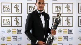 Mohamed Salah congratulates Virgil van Dijk after he pips Raheem Sterling to PFA Player of Year award