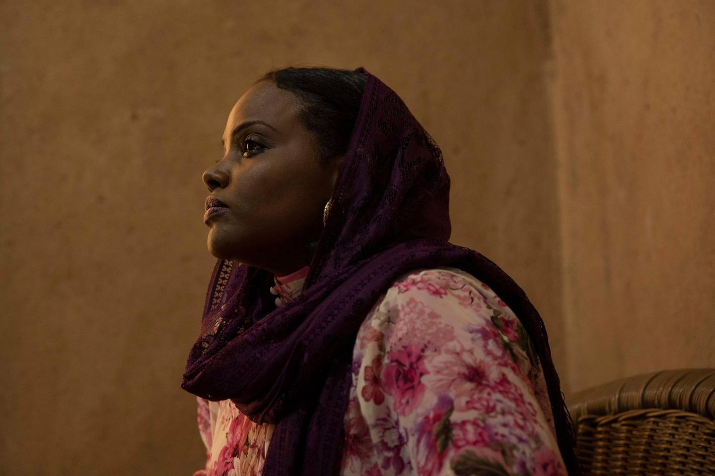 In this Jan. 11, 2020 photo, Sudanese psychologist Sulima Ishaq Sharif listens during an interview, in Khartoum, Sudan. Over the past year, activists have been steadily documenting rape victims from the June 3, 2019 crackdown on a protest camp. They believe it was a coordinated campaign ordered by the military's top leadership to crush the spirit of the pro-democracy movement. Sharif, who at the time headed a trauma center at Khartoum's Ahfad University said her center documented at least 64 rape victims. The number is likely considerably higher, since many victims don't speak because of fear or the stigma connected to rape. They said hundreds more women were sexually assaulted. (AP Photo/Nariman El-Mofty)