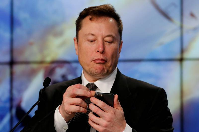FILE PHOTO: SpaceX founder and chief engineer Elon Musk looks at his mobile phone during a post-launch news conference to discuss the  SpaceX Crew Dragon astronaut capsule in-flight abort test at the Kennedy Space Center in Cape Canaveral, Florida, U.S. January 19, 2020. REUTERS/Joe Skipper/File Photo