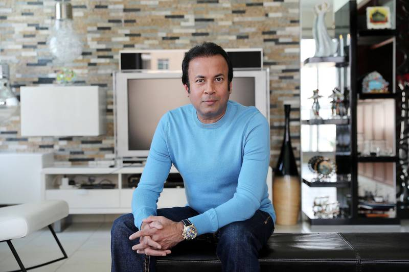 DUBAI, UNITED ARAB EMIRATES , October 5 – 2020 :-  Farhan Kapadia at his home in The Residences tower in Downtown Dubai in Dubai. (Pawan Singh / The National) For Business. Story by Deepthi