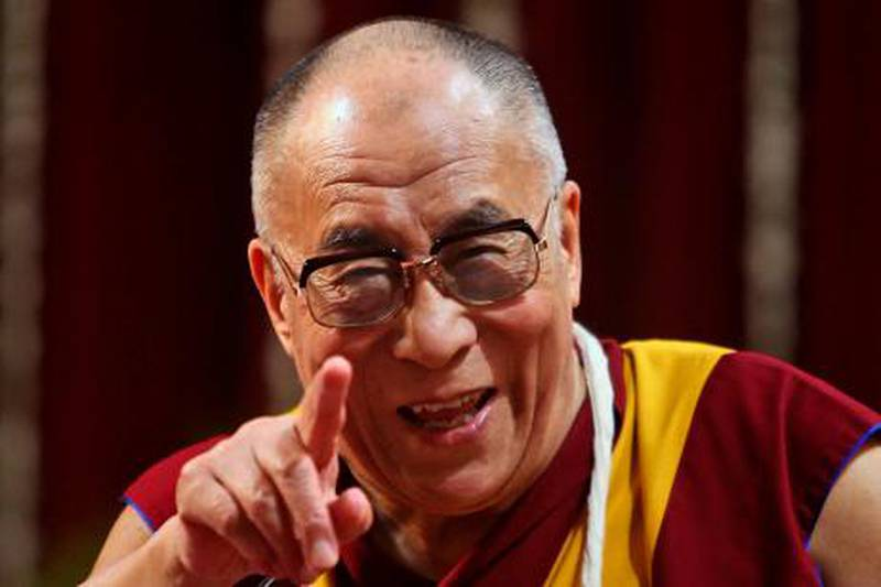 """FILE - In this Feb. 18, 2011 file photo, Tibetan spiritual leader the Dalai Lama gestures as he addresses the Mumbai University students in Mumbai, India. The Dalai Lama said Thursday, March 10, 2011, that he will give up his political role in Tibet's government-in-exile, shifting that power to an elected representative. The Tibetan spiritual leader, speaking on the anniversary of the 1959 Tibetan uprising against Chinese control, said the time has come """"to devolve my formal authority to the elected leader."""" (AP Photo/Rafiq Maqbool, File) *** Local Caption ***  TOK101_India_Dalai_Lama.jpg"""