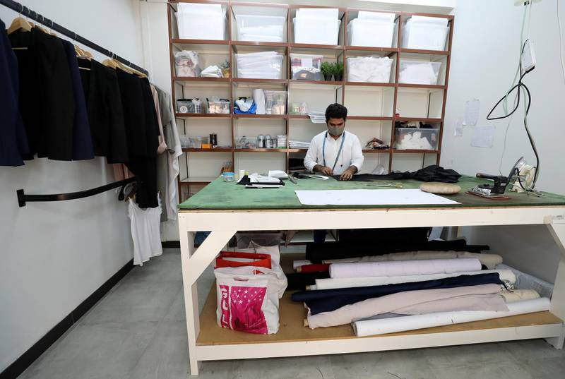 Dubai, United Arab Emirates - Reporter: N/A. Standalone. Covid-19/Coronavirus. Tailor Zeeshan Javed makes a pair of trousers with Coivd protection measures in place. Thursday, August 27th, 2020. Dubai. Chris Whiteoak / The National
