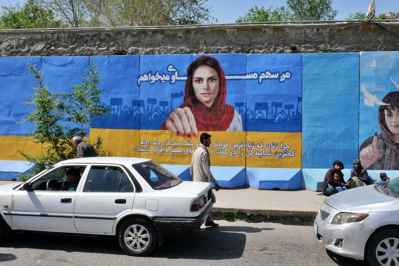 """Pictured: ArtLords' most recent mural in Kabul asking the question """"Why do the women of Afghanistan who suffered the most in the wars have the least representation in the Afghan Peace Process?""""Photo by Charlie Faulkner April 2021"""