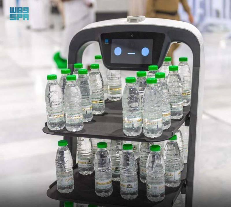 Robots serving Zamzam water bottles at the Grand Mosque in Makkah. SPA