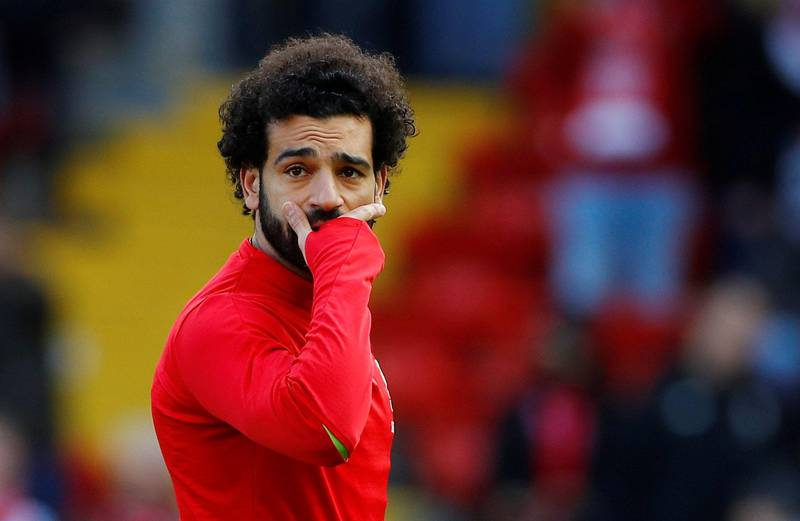 """Soccer Football - Premier League - Liverpool v AFC Bournemouth - Anfield, Liverpool, Britain - February 9, 2019  Liverpool's Mohamed Salah during the warm up before the match   REUTERS/Phil Noble  EDITORIAL USE ONLY. No use with unauthorized audio, video, data, fixture lists, club/league logos or """"live"""" services. Online in-match use limited to 75 images, no video emulation. No use in betting, games or single club/league/player publications.  Please contact your account representative for further details."""