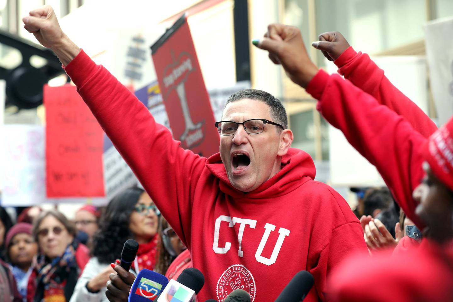 FILE PHOTO: Chicago Teachers Union President Jesse Sharkey cheers during a rally on the first day of a teacher strike in Chicago, Illinois, U.S., October 17, 2019.  REUTERS/John Gress/File Photo
