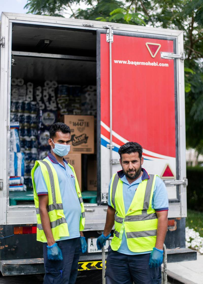 """DUBAI, UNITED ARAB EMIRATES. 24 MARCH 2020. Soyab Bhasea, 25, India, and Mohammad Zayed, 31, Pakistan, work for a distributors company, and they deliver goods to supermarkets and warehouses. Mohammad says that he has to continue his work in these times and """"Allah Hafiz"""" (God will protect us).(Photo: Reem Mohammed/The National)Reporter:Section: UAE HEROES"""