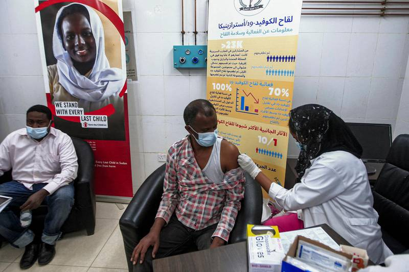 A man receives a dose of the Oxford-AstraZeneca COVID-19 coronavirus vaccine at the Jabra Hospital for Emergency and Injuries in Sudan's capital Khartoum on March 9, 2021. - Sudan is the first in the Middle East and North Africa to receive vaccines through COVAX, a UN-led initiative that provides jabs to poor countries, according to children's agency UNICEF. The first batch to arrive was comprised of 828,000 doses of the AstraZeneca vaccine, which are planned to cover 414,000 frontline health care workers across the country, according to health officials. (Photo by Ebrahim HAMID / AFP)