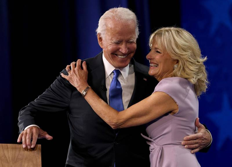 WILMINGTON, DELAWARE - AUGUST 20: : Democratic presidential nominee Joe Biden greets his wife Dr. Jill Biden on the fourth night of the Democratic National Convention from the Chase Center on August 20, 2020 in Wilmington, Delaware. The convention, which was once expected to draw 50,000 people to Milwaukee, Wisconsin, is now taking place virtually due to the coronavirus pandemic.   Win McNamee/Getty Images/AFP