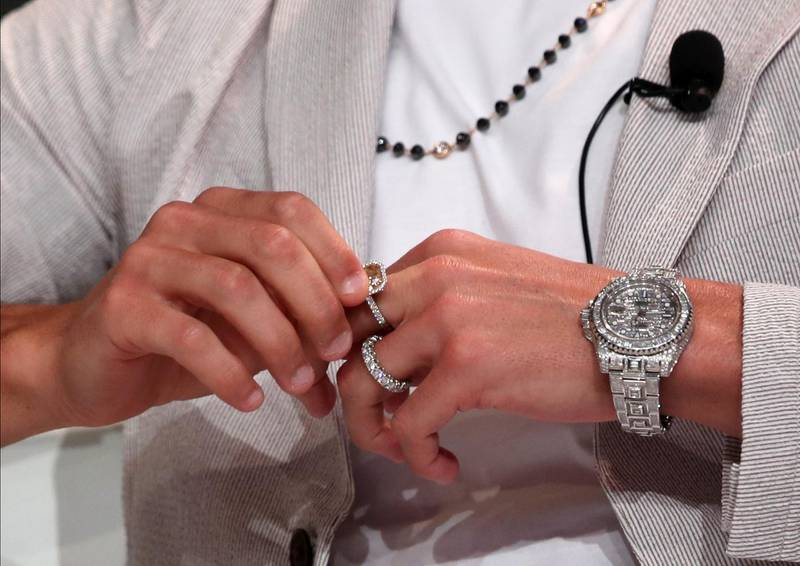 epa08092394 Portuguese international Cristiano Ronaldo of Juventus Turin sports expensive jewellery as he attends during the 14th edition of Dubai International Sports Conference in Dubai, United Arab Emirates, 28 December 2019. The conference was launched in 2006 to bring football stakeholders together.  EPA/ALI HAIDER