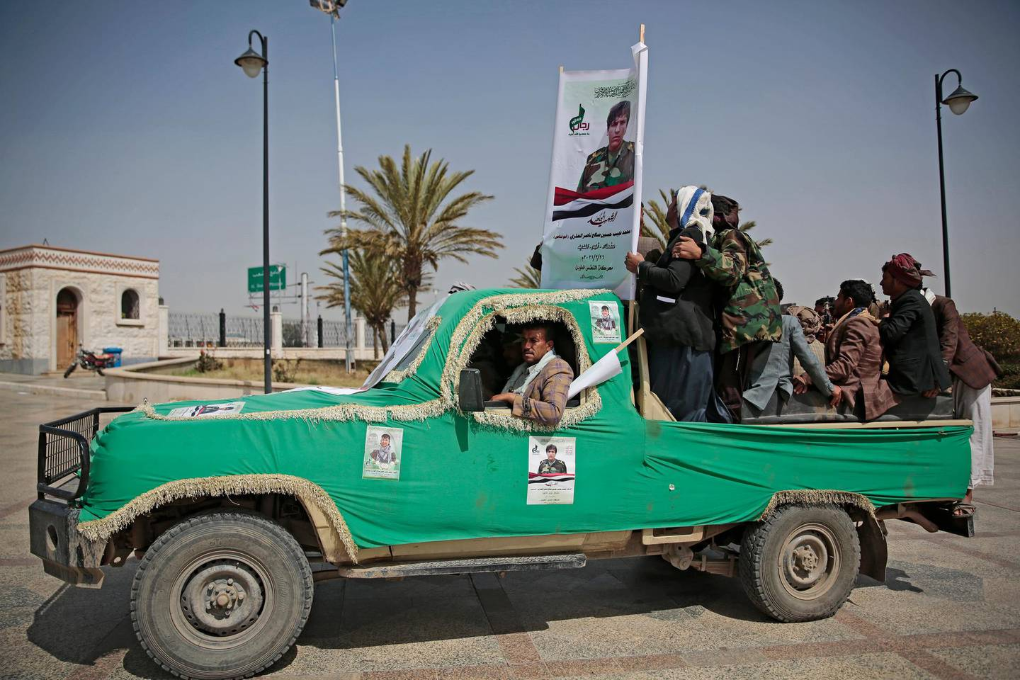 Armed Houthi fighters ride on a vehicle as they attend the funeral procession of Houthi rebel fighters who were killed in recent fighting with forces of Yemen's internationally recognized government in Sanaa, Yemen, Tuesday, Mar. 2, 2021. (AP Photo/Hani Mohammed)